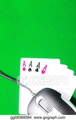 An online gaming concept with computer mouse, four aces and green felt