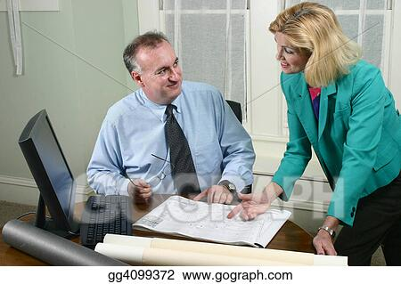 Architect And Client Looking At Blueprints 3