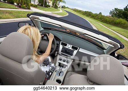 Beautiful Young Woman Driving Convertible Car