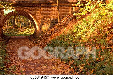 Brick bridge in the autumn forest in Russia