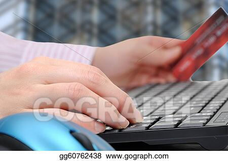 Business woman using computer for internet shopping. 