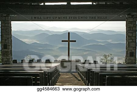 Church with a view of the mountains.