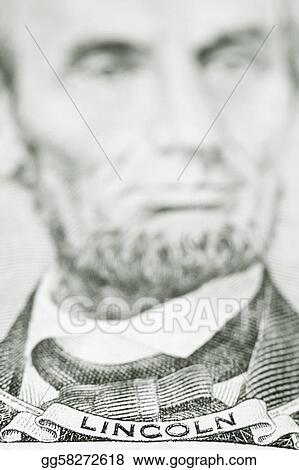 Close up of President Lincoln on five dollar bill