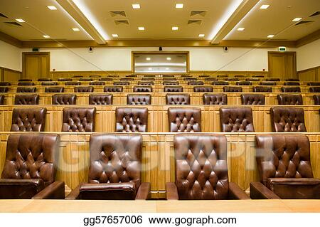 Conference halls with magnificent leather armchairs and wooden tables with microphones
