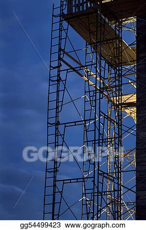 construction scaffolding against nighttime sky