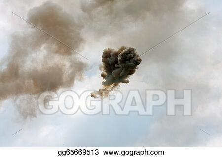 Dangerous and dramatic cloud of black smoke after an explosion i