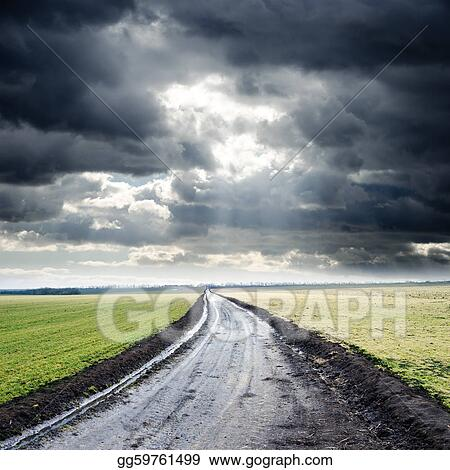 dirty road to cloudy horizon. rain before
