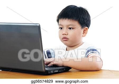 Elementary schoolboy using laptop