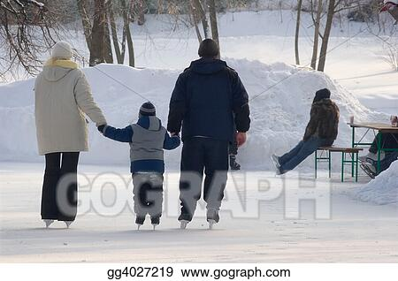 Family on a skating rink