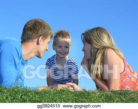family on grass face