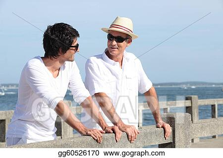 Father and son stood on promenade