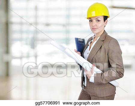 Female architect holding blueprints with helmet on head