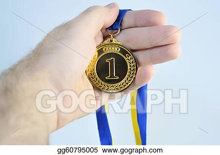 Hand holding beautiful golden (medal) trophy