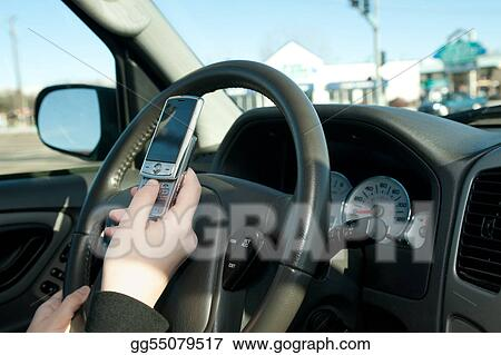 Hand of a teen texting while driving