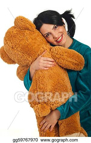 Happy woman hugging teddy bear