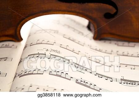 Light through violin's ribs on music score