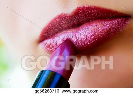 Macro view of female lips and red lipstick