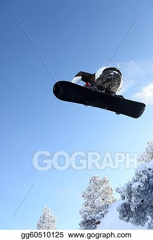 Male snowboarder performing trick
