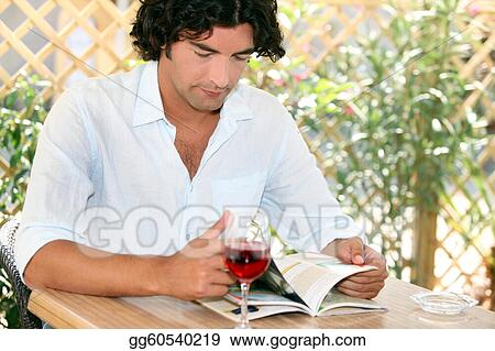 Man drinking wine on restaurant terrace