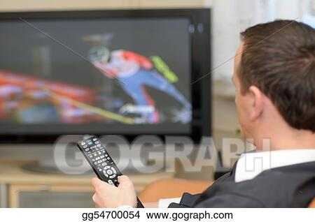 Man holding a remote control while watching TV.