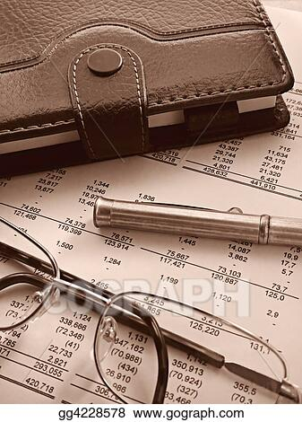 organizer, pen and glasses on financial statement