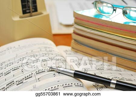 Pen on music score with music books