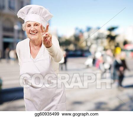 portrait of cook senior woman doing good gesture at crowded street