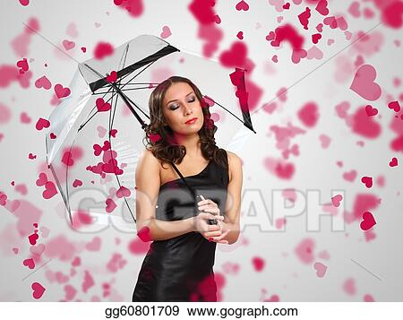 Pretty woman under umbrella with petals around her