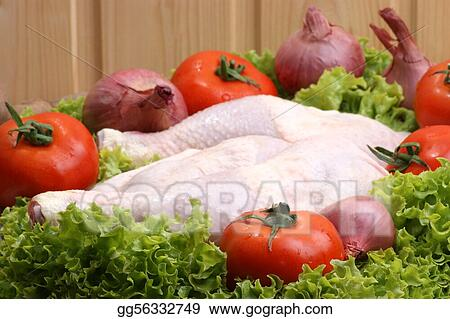 raw organic chicken drumstick with onion and tomato