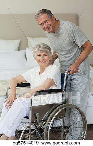 Retired woman in her wheelchair with her husband