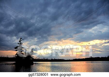 Scenic Island on a Remote Wilderness Lake with Dramatic Sky