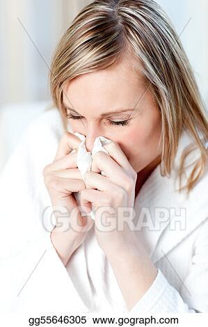 Sick woman blowing