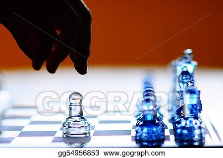 Silhouette hand making chess pawn move