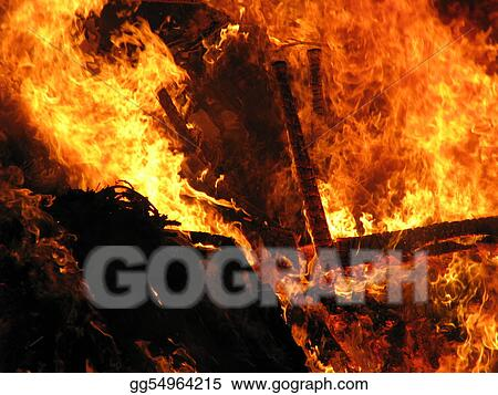 Some household furniture ablaze in a fire