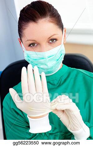 Sophisticated surgeon wearing scrubs and a mask in a hospital