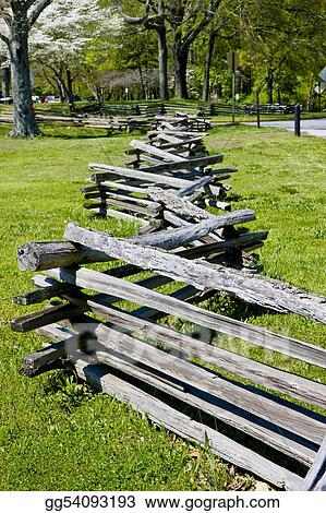 Split Rail Fence Across Grass Field