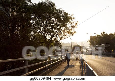 Sunset walkway along the road