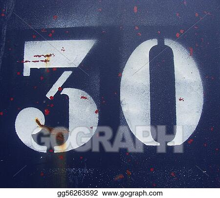 the number 30 thirty sprayed in white on a rusty blue metal plate