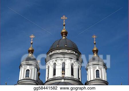 three cupolas and crosses against the blue sky