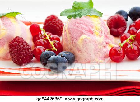 Three scoops of raspberry ice cream with fresh fruit