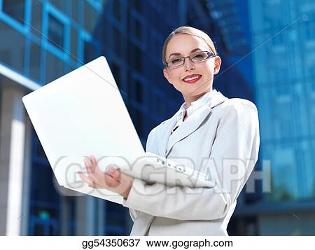 Title  Caption Beautiful business woman standing outdoor modern building Keywords associate, attractive, beautiful, beauty, blue, building, business, businesswoman, career, caucasian, ceo, city, computer, confident, consultant, corporate, cute, executive