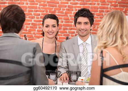 Two couple having meal in restaurant
