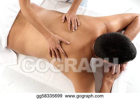 Unrecognizable man receiving massage relax treatment close-up from female hands