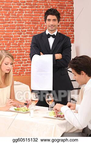 Waiter stood by couple enjoying meal