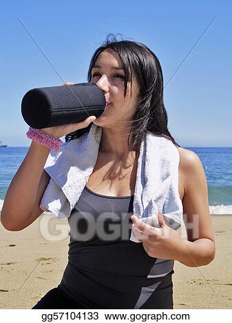Woman resting and drinking after physical exercise