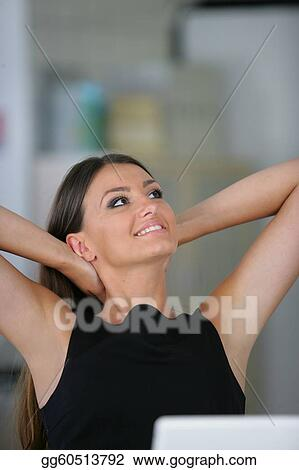 Woman sat at her desk stretching