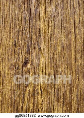 Worn old yellow brown wood with remains of tar paint, background or texture