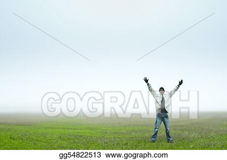 Young adult standing in field with arms outstretched