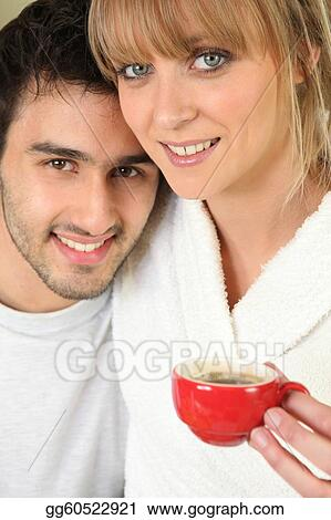 Young couple having an early morning cup of coffee