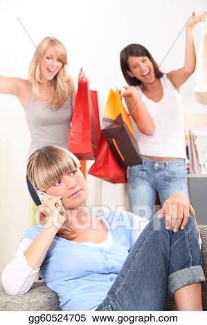 Young woman on the telephone as her friends walk in with bags of retail purchases